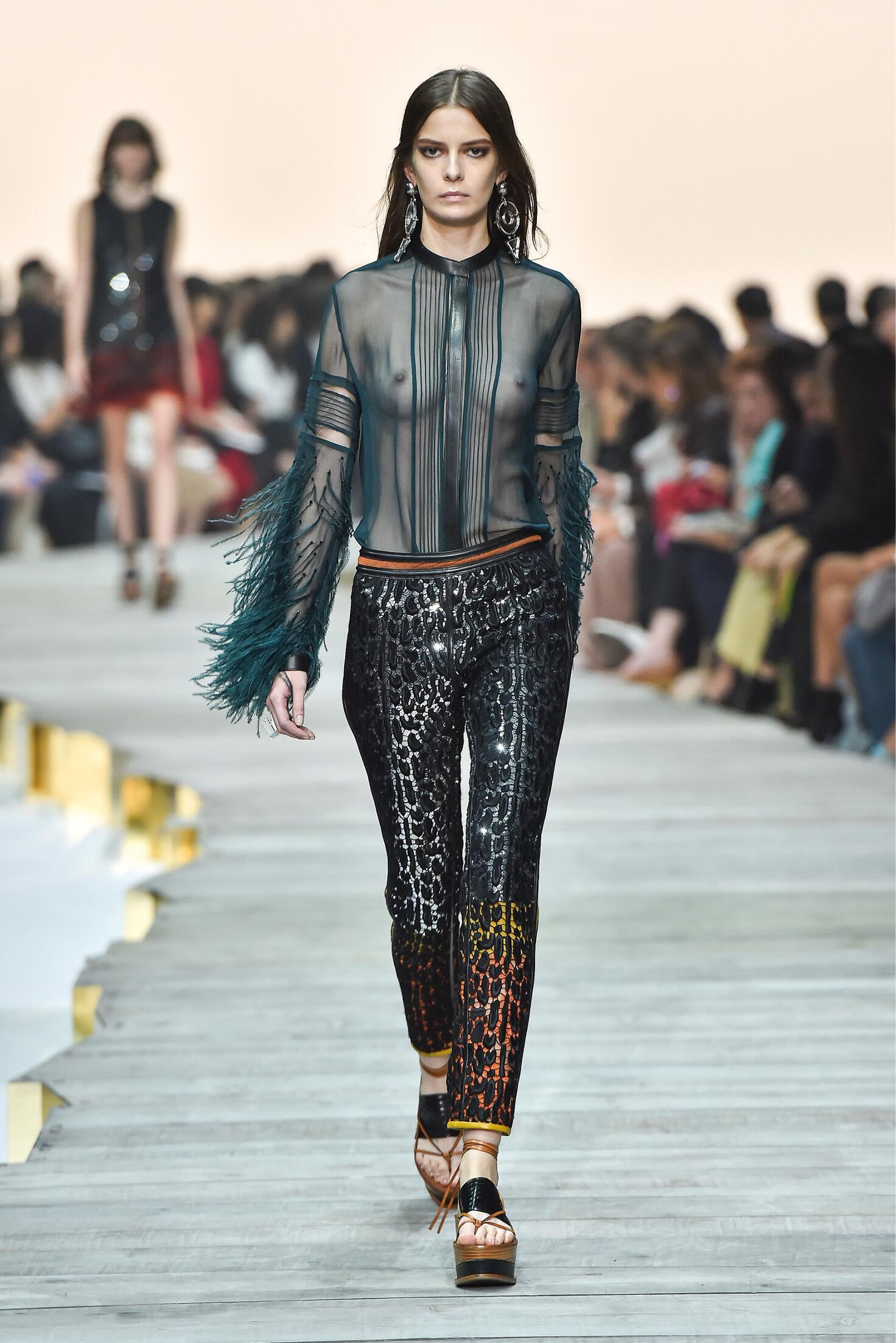 Roberto Cavalli clothing includes an assortment of leopard-print dresses, metallic jackets, floral gowns, boot-cut pants and tiered maxi skirts, each of which exudes elegance and unconventional charm.