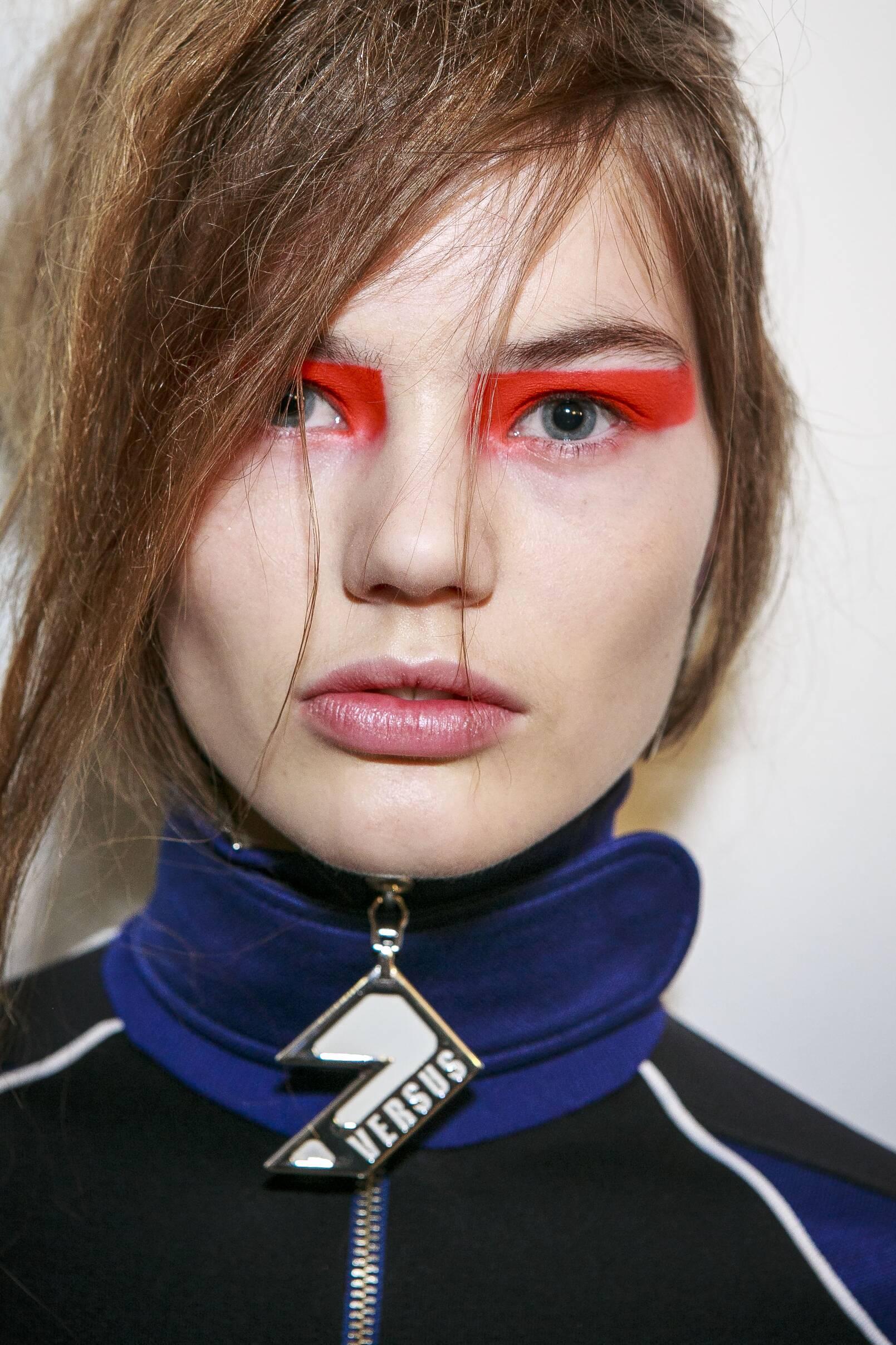 Model Backstage Versus Versace Fashion Show
